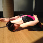 Woman Doing Leg Behind Head Yoga Pose