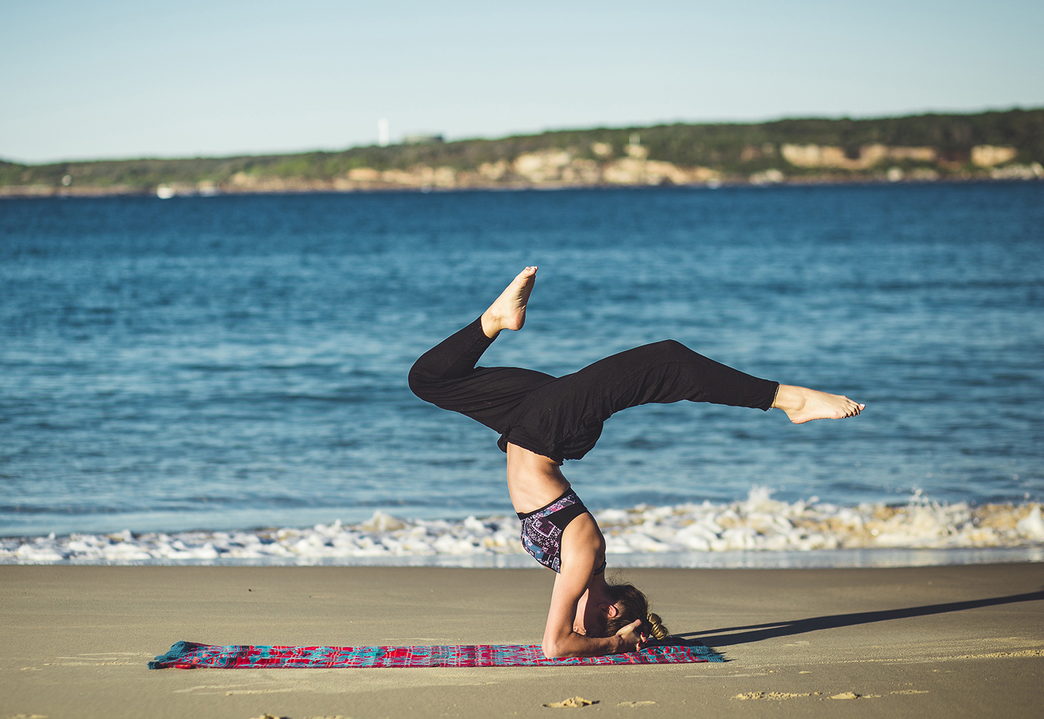 Fit Woman Doing Headstand Yoga Pose Outdoors