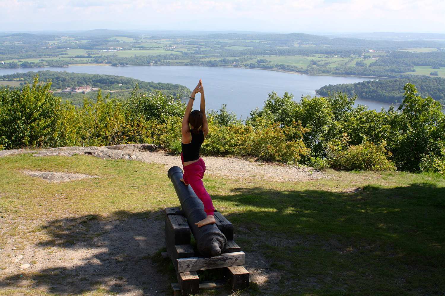 Woman Doing Crescent Lunge Pose In Nature