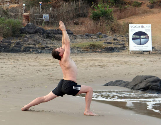 Fitness Man Doing Crescent Lunge Yoga Pose Outdoors