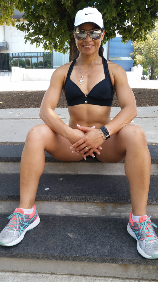 Athletic Woman Sitting Outdoors