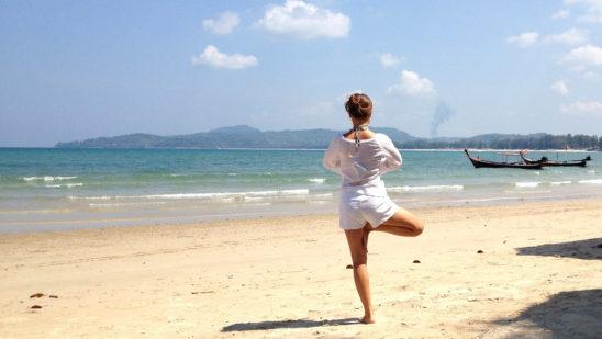 Yogi Practicing Yoga At The Beach. Yoga Tree Pose