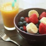 Mango Juice In Glass and Fruit Salad In Bowl