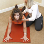 Yoga Instructor Helping A Client Stretch