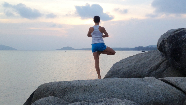 Yogi Doing Tree Pose in Nature. Balance Yoga Pose