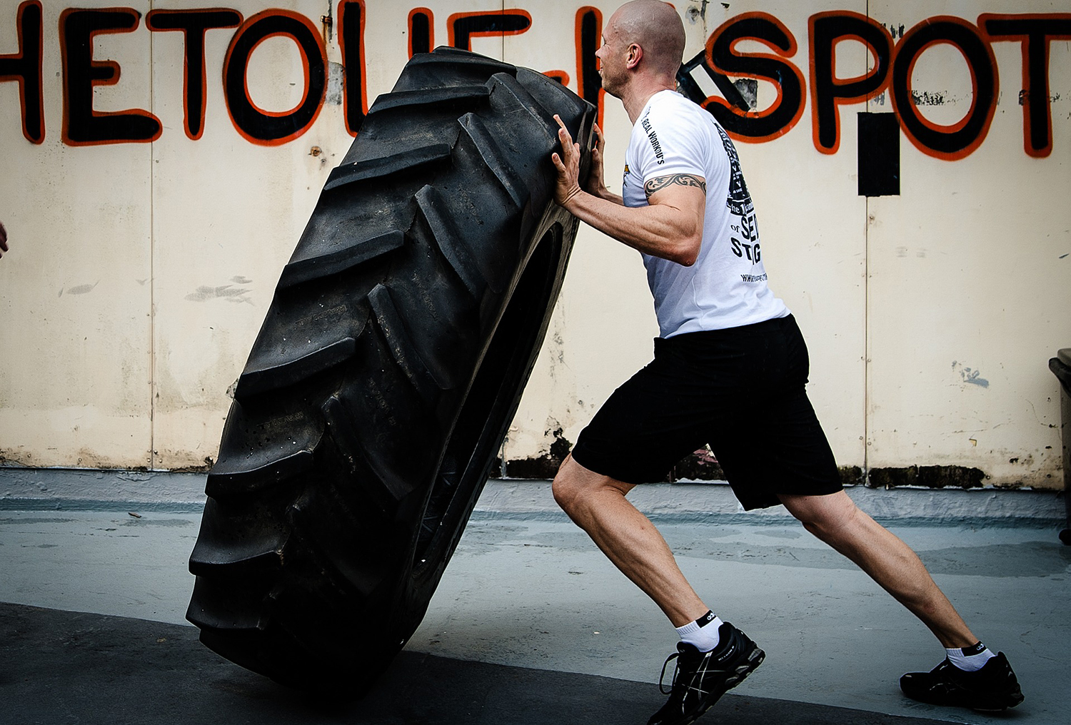 Crossfit Man Doing Tyre Flipping Exercise