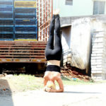 Athletic Woman Doing Headstand Outdoors