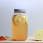 Lemonade Juice in Mason Jar and Cut Lemon Slice