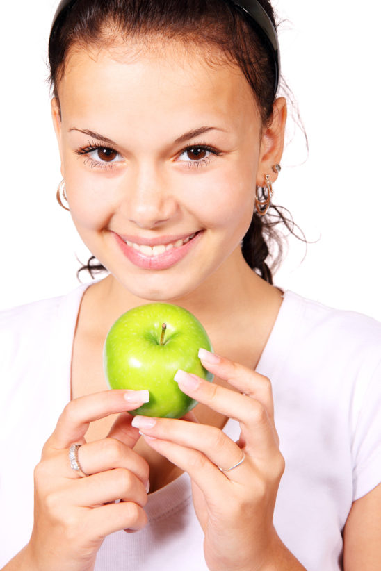 Smiling Woman Holding Green Apple