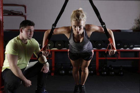 28 trainer motivating woman to exercise