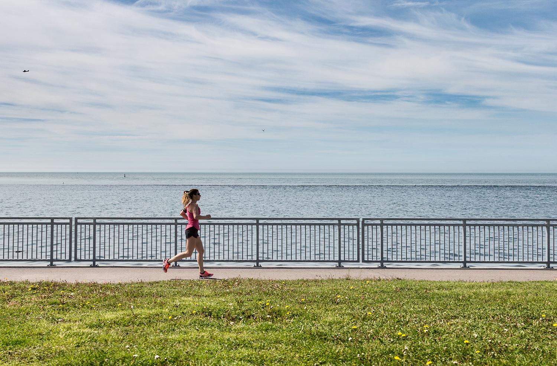 Morning Runner Exercising Along The Ocean