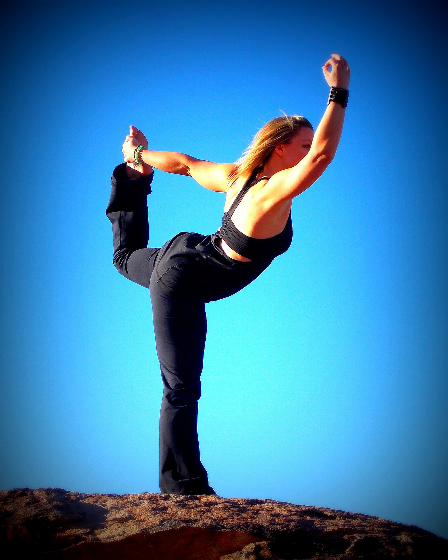 Healthy Woman Doing Yoga Outdoors. Balancing Dancer's Pose