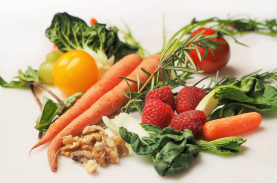 Healthy Foods. Carrots, Kale, Walnuts, Tomatoes, and Strawberries