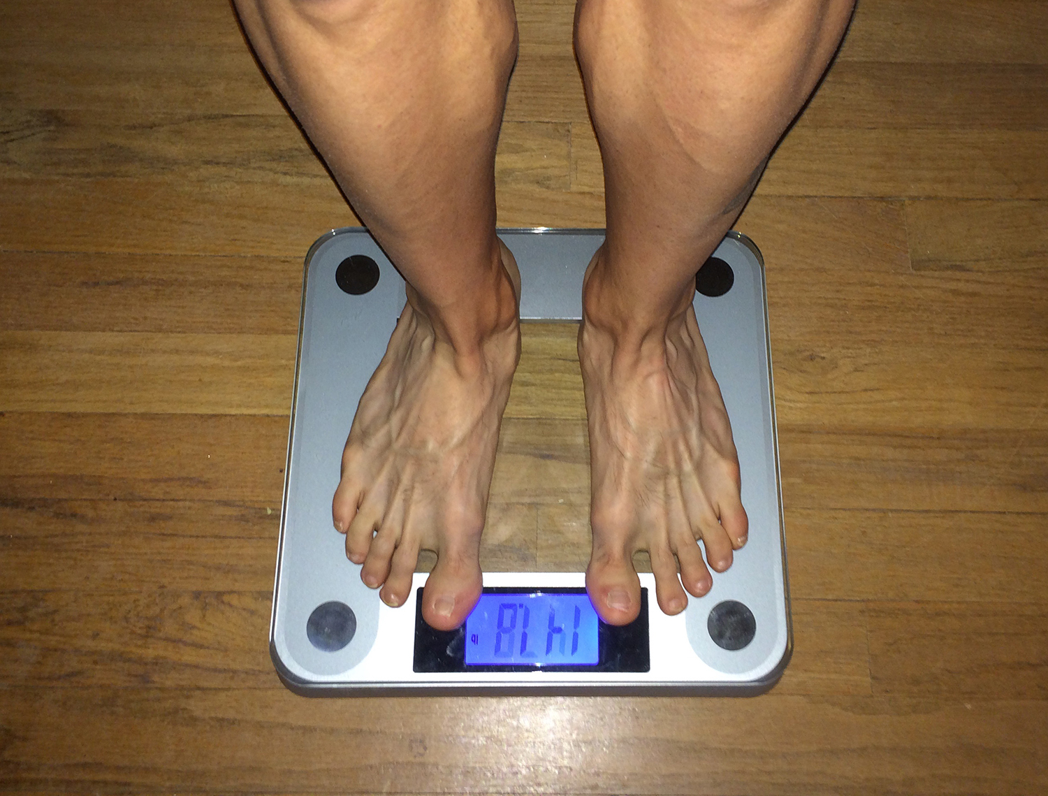 Person Stepping on Weight Scale