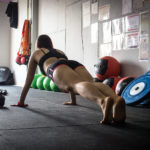 Fit Woman Doing Push Ups and Planks In The Garage