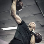Strong Man Lifting Kettlebells