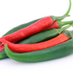 Red Pepper and Green Pepper Isolated on White Background
