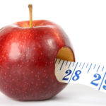 Apple and Tape Measure Dieting Concept