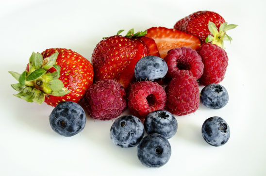 Close-up Shot of Strawberries, Raspberries, and Blueberries
