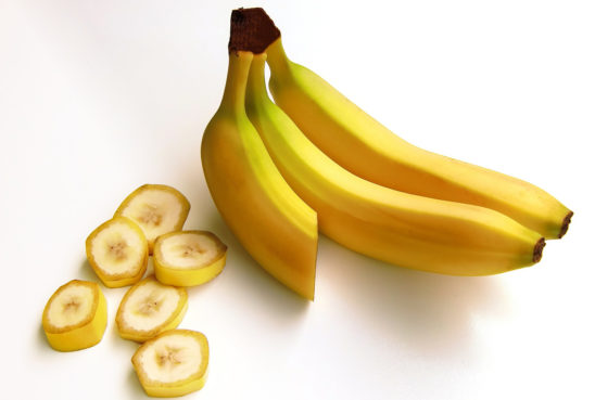 Three Bananas and Banana Slices Isolated on White Background