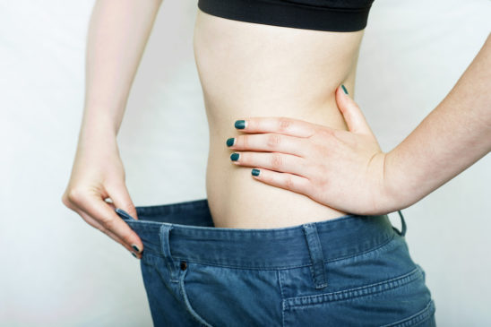 Weight Loss Concept, Woman Wearing Buggy Jeans After Weight Loss