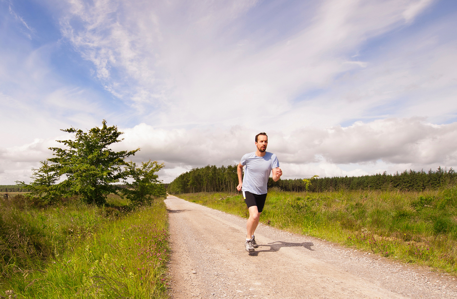 Fitness Man Sprinting Outdoors