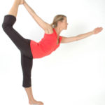 Fit Woman Doing Balancing Yoga Pose. Dancer's Pose/ Standing Pulling Bow Pose