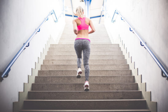 Sporty Woman Running On The Stairs
