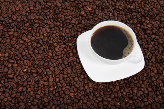 Cup Of Coffee Placed on Coffee Beans