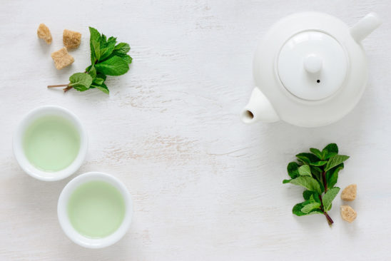 Green Tea and Kettle on A Table
