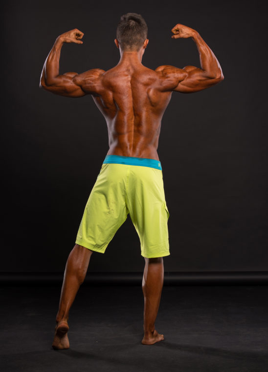 Male Bodybuilder Flexing Back Muscles