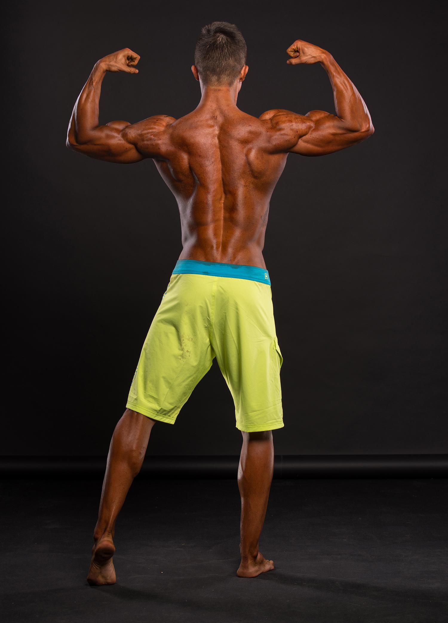 Male Bodybuilder Flexing Back Muscles