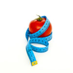 Tomato and Tape Measure Dieting Concept