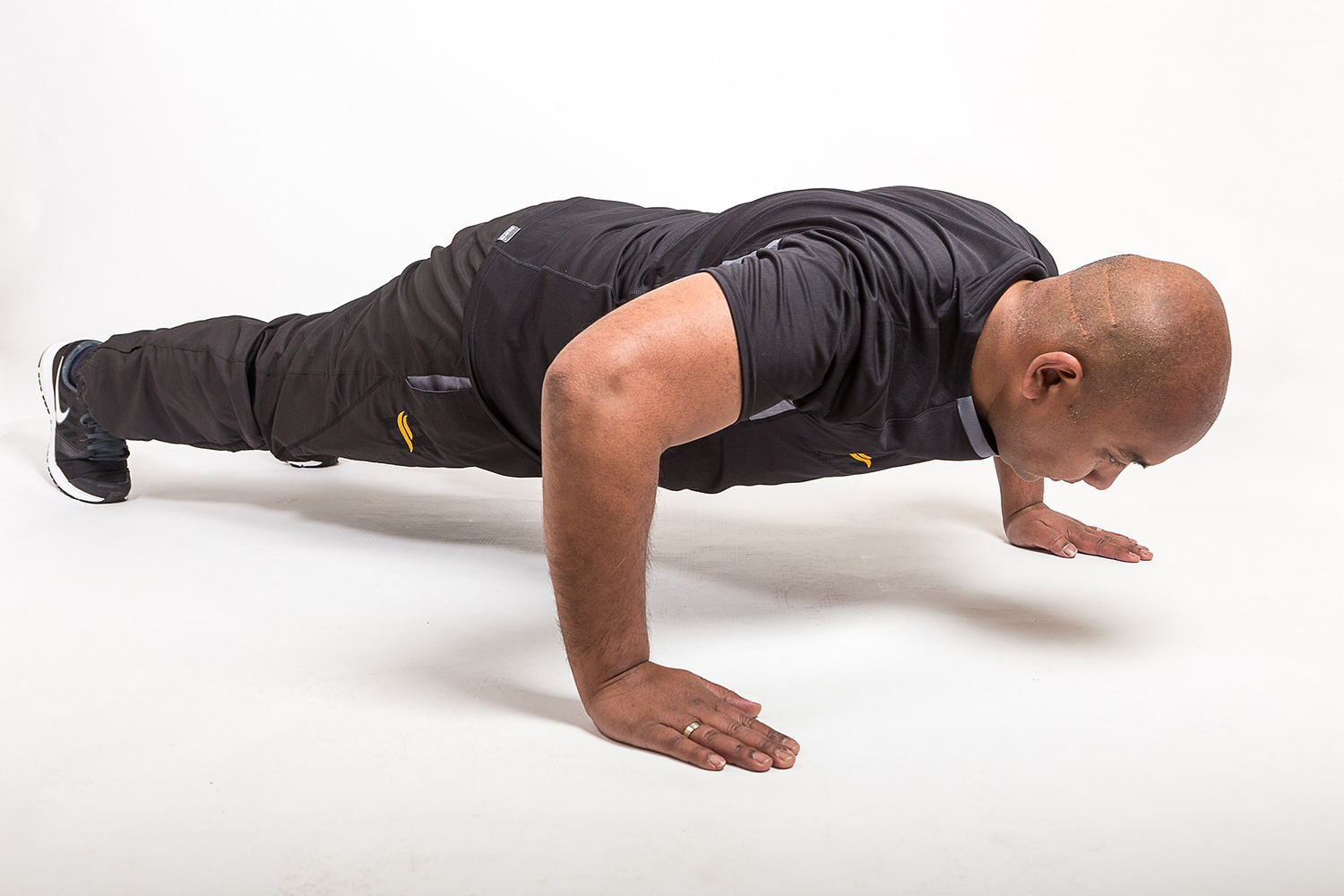 Fit Trainer Doing Push Ups