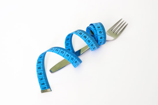 Folks and Tape Measure Dieting Concept