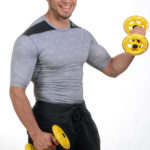Smiling Muscular Man Lifting Yellow Dumbbells
