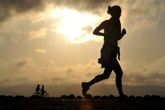 Woman Running In the Evening Silhouette Illustration