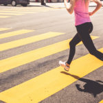 Athletic Woman Running Over the Pedestrian Crossing