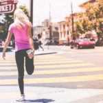 Athletic Woman Stretching Legs Before Running