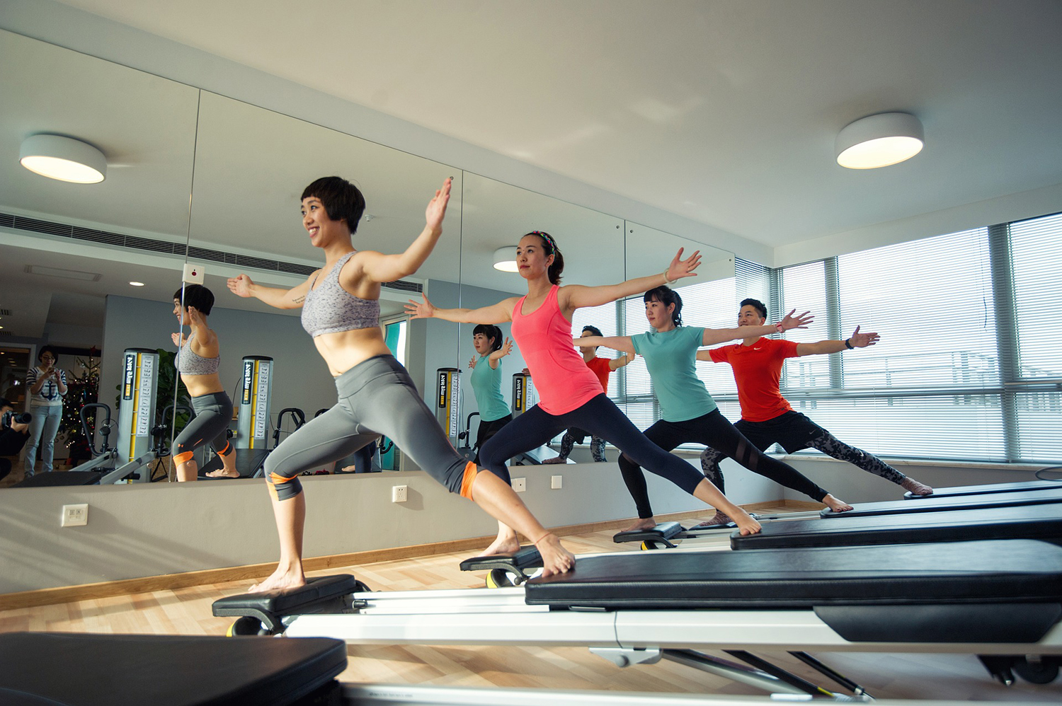 Healthy Women Exercising on Workout Machine