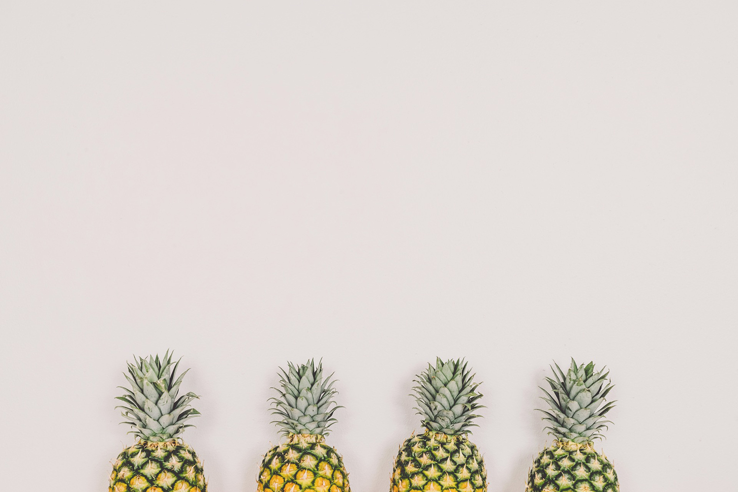 Four Pineapples on Isolated Background
