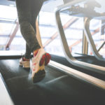 Athletic Woman Running on Treadmill