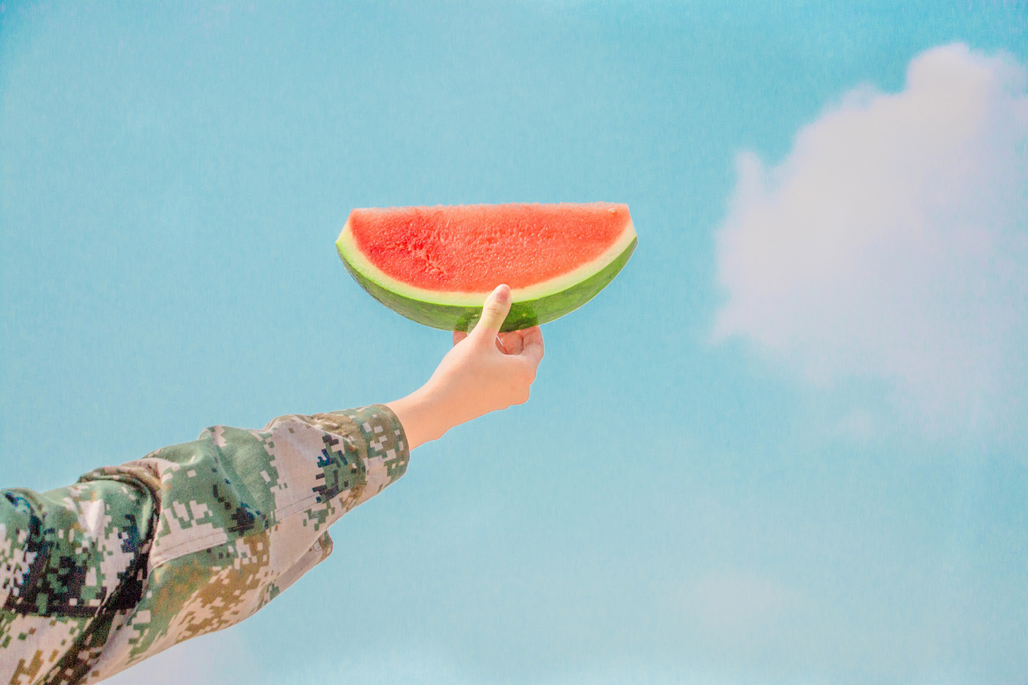 Hand Holding Watermelon Slice Outdoors