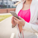 Fit Runner Listening To Music After Workout