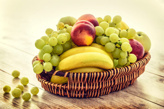Healthy Eating. Bananas, Apples, and Grapes in A Basket