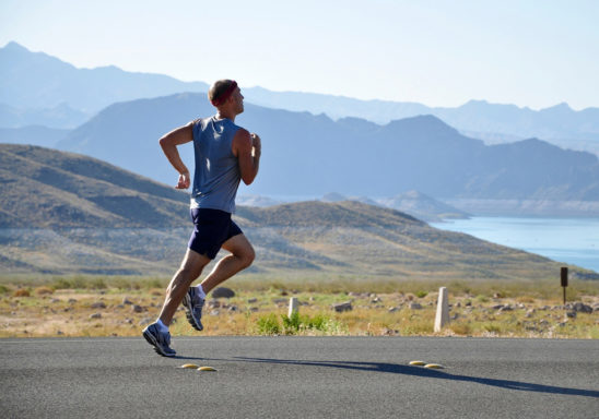 Athletic Man Running on The Road