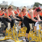 Outdoor Fitness Class Exercising on Stationary Bikes