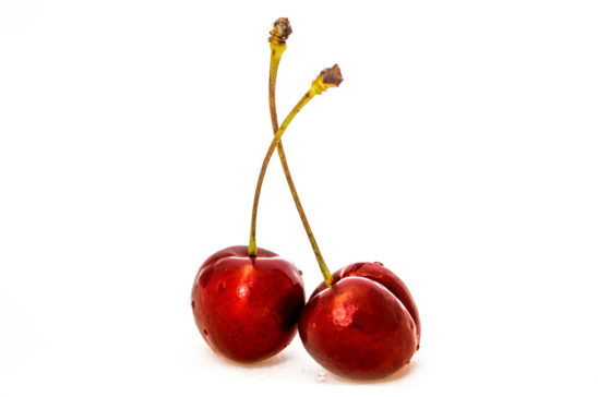 Two Red Cherries Isolated on White Background