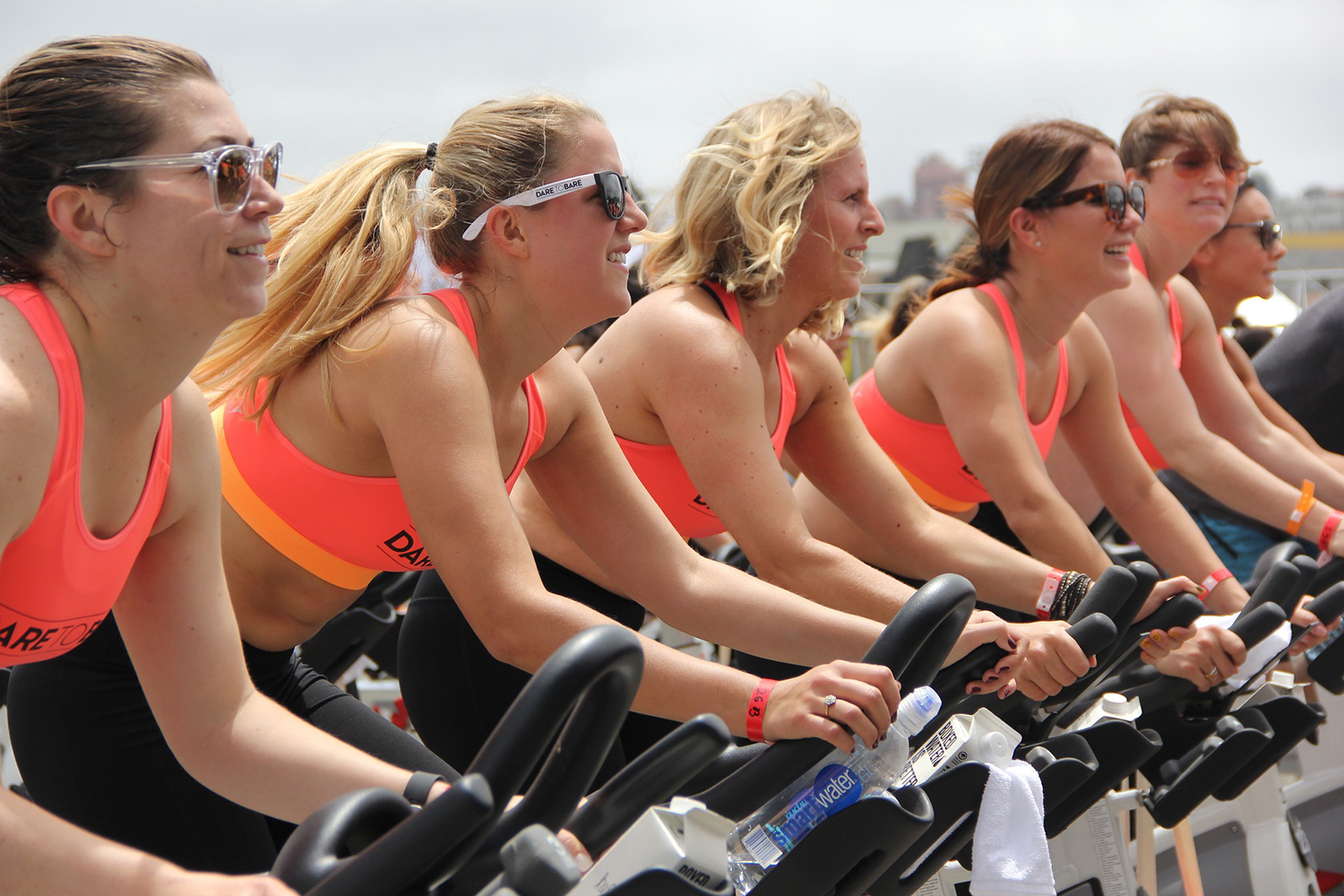 Fitness Group Doing Cardio on Stationary Bikes Outdoors