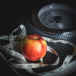 Weight Loss Concept. Weight Scale,Tape Measure, and Apple